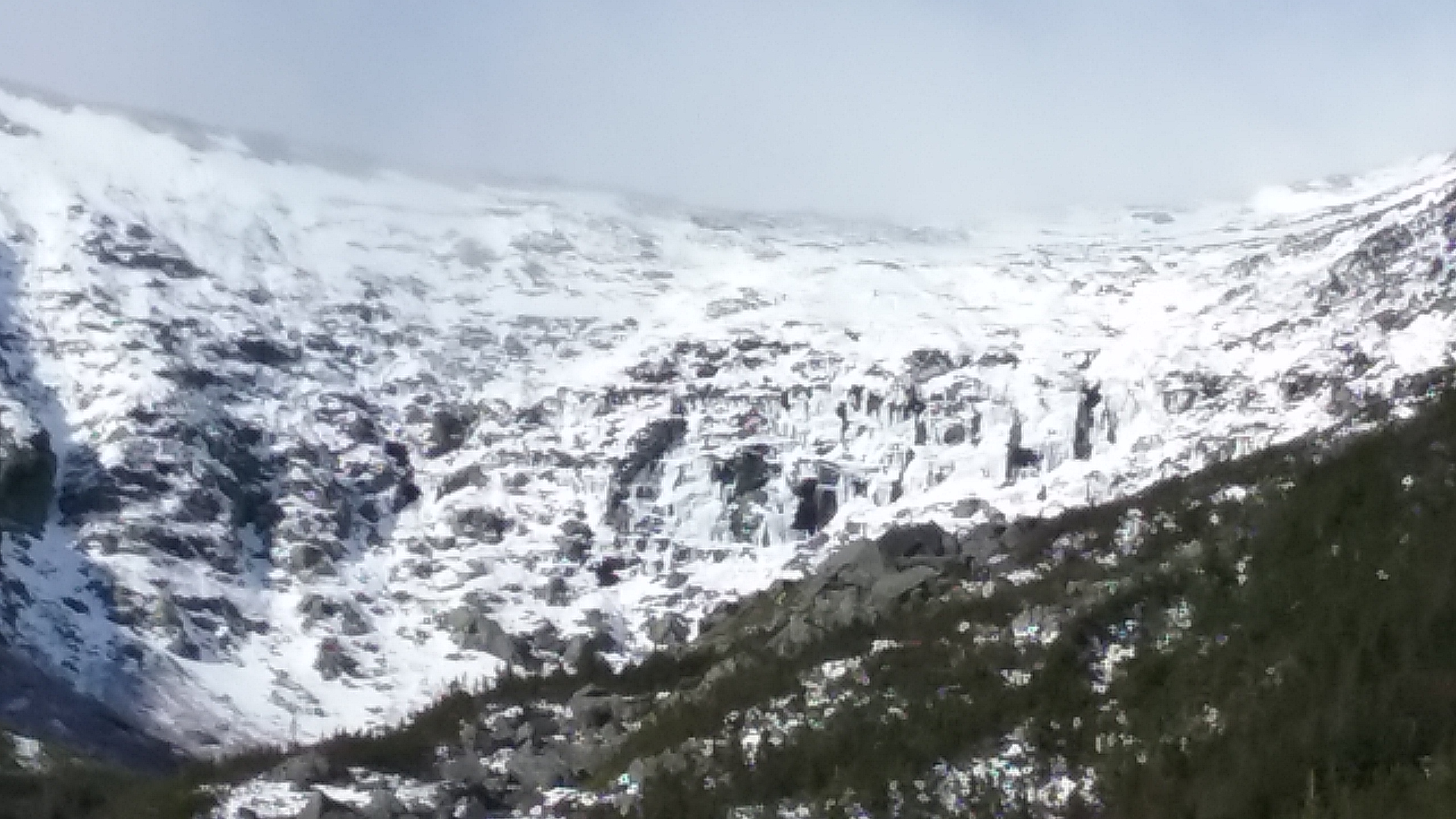 Headwall area with loads of ice with varying degrees of holding power. No doubt the cliff will shed some ice this week.